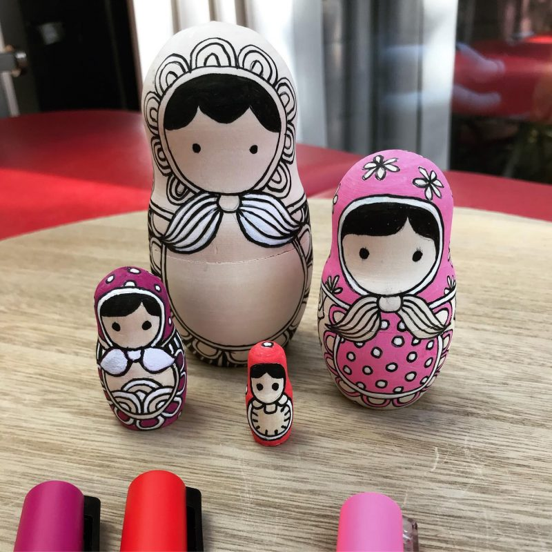 Painting blank nested dolls by Tazi